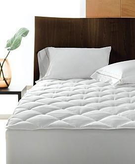 Nadvložek za vodo posteljo